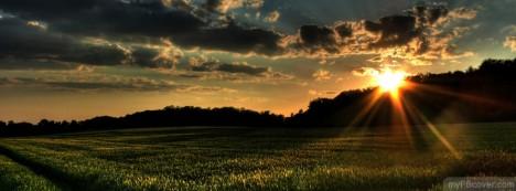 Sun rising at horizon Facebook Cover